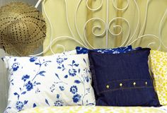 Pillows and straw hat on an iron bed in the bedroom in the style of Provence stock images