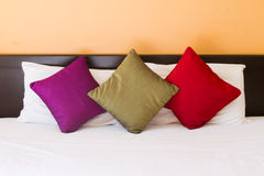 Pillows in three colors Stock Photos