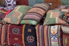 Pillows, turkish market. Colorful arabic pillows and carpets Stock Image