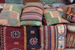 Pillows, turkish market. Colorful arabic pillows and carpets Royalty Free Stock Photography