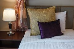 Pillows on white bed sheet bedding and lamp on bed side table. Twin beds room hotel resort apartment lodge inn residential service. Accommodation, interior stock photo