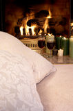 Pillows wine candles fireplace Royalty Free Stock Photography