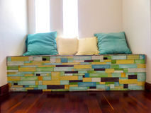 Pillows on wood pieces bench random fancy color on surface Royalty Free Stock Photography