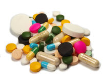 Pills. Macro photo of pills heap isolated on white Stock Images