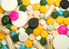 Pills. Macro photo of pills heap isolated on white Royalty Free Stock Photography