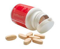 Pills. Isolated Pills in front of red bottle stock images