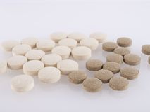 Pills. Vitamin pills on gray - medicine background - reflection Royalty Free Stock Photography