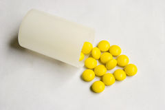 Pills. Yellow pills out of a bottle Stock Images