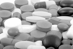 Pills. Black and white pills as a background Royalty Free Stock Image