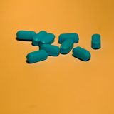 Pills. Blue Pills with on an orange background Stock Photos