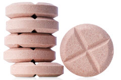Pills. Closeup of pink pills on white Royalty Free Stock Images