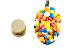 Pills. A lot of isolated pills and medicines with euro coins Royalty Free Stock Photo
