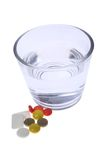 Pills. Glass of water and dose of pills Stock Photos