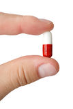 Pills. A pill on a white background Royalty Free Stock Photo