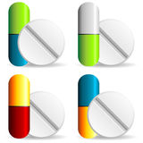 Pills. Medical capsules with different colors over white background Stock Photo