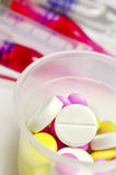 Pills. Colorful tablets with capsules in park Royalty Free Stock Images