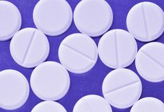 Pills. A lots of pills toning in a blue color royalty free stock photo