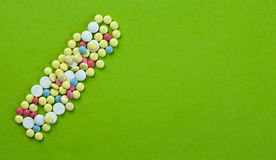 Pills. Group of colored pills on green paper Stock Photo
