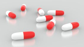 Pills. Red and white medicine capsules Stock Photos