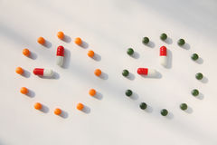 Pills. Clock made from pills on white background stock photography