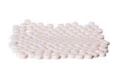 Pills. White round pills on white background Royalty Free Stock Photos