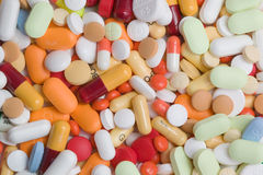 Pills. Various pills and capsules, one normal weekly dose of tablets for men of woman Stock Photos
