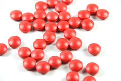 Pills. Red pills on a white background close up royalty free stock photo