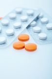 Pills. White and orange pills on the table Royalty Free Stock Images