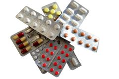 Pills. A selection of pills, tablets or medication, over white background Stock Images