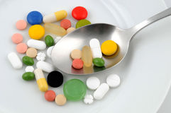 Pills. Some medicine on a white plate Stock Photography