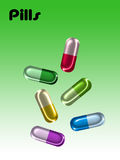 Pills. Different colors pills, capsules on green-white gradient background Royalty Free Stock Image