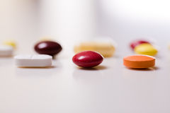 Pills. On white background; Shallow depth of field Stock Photo