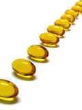 Pills. In a row Royalty Free Stock Photos