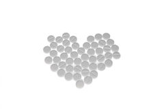 Pills. White pills in the form of heart isolated on white Royalty Free Stock Photos