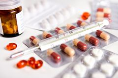Pills. And thermometer Royalty Free Stock Photo