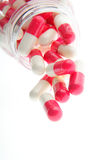 Pills. Red-white pills on a white background Royalty Free Stock Photography