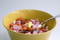 Pills in abowl. Lots of pills in a bowl Royalty Free Stock Photo