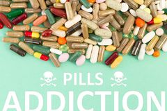 Pills addiction concept. With various drugs and health hazard skull symbol stock photography