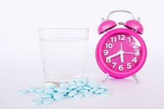 Pills And Alarm Clock On White Background Royalty Free Stock Images