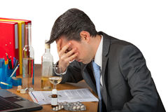 Pills and alcohol abuse in business Royalty Free Stock Images