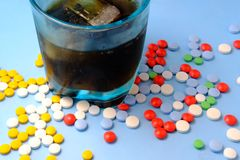 Pills and alcohol on the table, dependency concept.  Stock Images