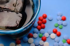 Pills and alcohol on the table, dependency concept.  Royalty Free Stock Images