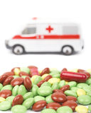 Pills and ambulance car Stock Image