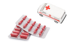 Pills and an ambulance car Royalty Free Stock Photo