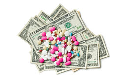 Pills on american dollars. Colorful pills on american dollars on white background stock images