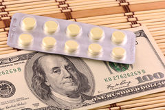 Pills and american money close-up background Stock Photo