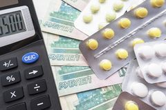 Pills And Calculator On The Background Of Russian Rubles Royalty Free Stock Image