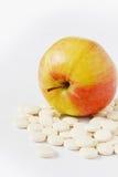 Pills and apple Stock Photos