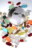 Pills around globe Royalty Free Stock Photo