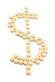 Pills Arranged  in Shape of Dollar Symbol Stock Image